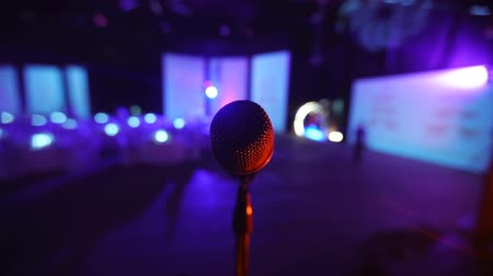 színpad : Microphone on stage at a concert venue 2 Stock mozgókép