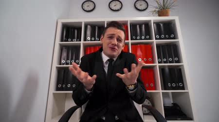 pleading : Handsome Businessman in formal suit and tie desperate can not help You with business deal. Sorry excuse apologise with client concept. Wide POV footage.