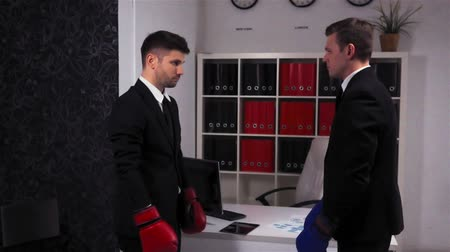 aktatáska : Two Young handsome attractive Businessmen Boxing in Office Room. Red and blue gloves. Super slow motion shot. Competition and fighting in office concept.