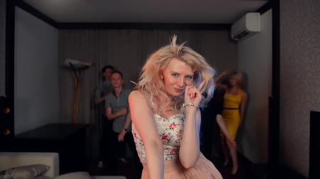 повод : Attractive blond female dance with happiness. She is completely given to passionate dancing at party. Slow motion combined with real time.