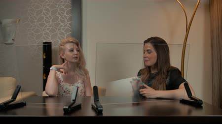 decorador : Two young sexy females looking at transparent display. They discussing about apartment price. Footage ready for connect Your infographics. Stock Footage