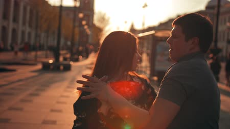 friendship dance : Love is in the air! Cute romantic couple spending time together in the city. male and sexy female hugging, kissing and having fun during the sunrise. Stock Footage
