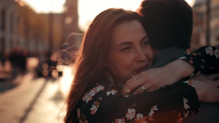 coming home : Happy couple embracing in love romantic and fun. Charming brunette woman with freckles running to hug her boyfriend at urban street. Stock Footage