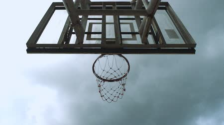 Basketball hoop with blue sky background, a player playing basketball and final scene ball clash camera Стоковые видеозаписи