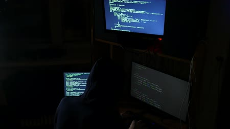 matriz : hacker hacked internet code, cybercriminal works, side view, top Stock Footage