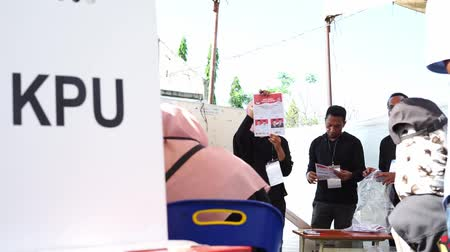 Banda Aceh, Indonesia - April 17, 2019: Officials sort and fold ballots for 2019 elections at a General Elections Committee (KPU) Polling Station In Kampung Mulia Banda Aceh, Aceh Province. Wideo