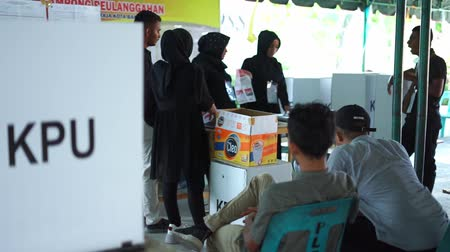 Banda Aceh, Indonesia - April 17, 2019: Officials sort and fold ballots for 2019 elections at a General Elections Committee (KPU) Polling Station In Pelanggahan Banda Aceh, Aceh Province.