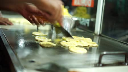 pastry ingredient : Vendor Frying Roti canaiIndian flat bread at street food market Stock Footage