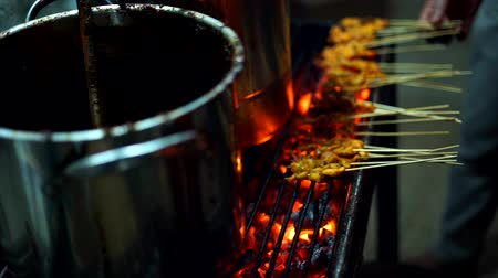 Grilled Chicken Satay  with Flame and Smoke at Streed food bazaar Stockvideo