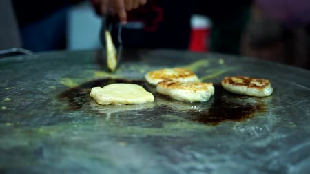 bread pan : Street Food Vendor making Roti Canai on a frying pan