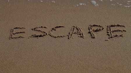 silme : escape, word, sand, sea, coast Stok Video