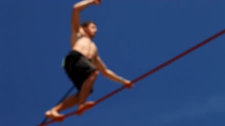 tightrope : tightrope walking on a high rope stretched Stock Footage