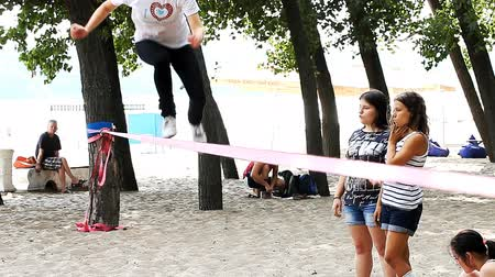 tightrope : Young people are trained Slacklining outdoors