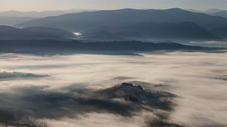 smokey : time lapse beautiful mountain landscape sunrise and fog in the mountains