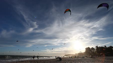 kitesurfer : Kitesurfers at sunset time