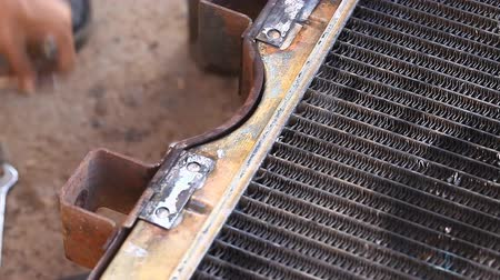car mechanic solder radiator