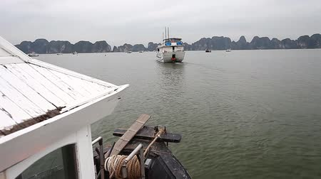 Bay Ha Long in Vietnam and a trip along the bay on board the Dragon boat Stock Footage