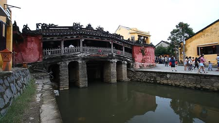 colonial : Tourism in Vietnam. The Japanese Covered Bridge - one of the main attractions of Hoi An