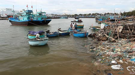 óceánok : Phan Thiet, Vietnam - January 08, 2017: Contaminated water with plastic, politilene and industrial waste on the citys waterfront. Bad waste management and pollution of the world ocean