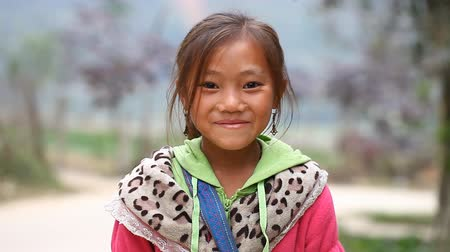 sapa people : Sapa, Vietnam - November 30, 2016 : A little girl from the ethnic group of Hmong poses the foreigner for the camera. Children often pose for this purpose to earn reward or to sell the souvenirs.