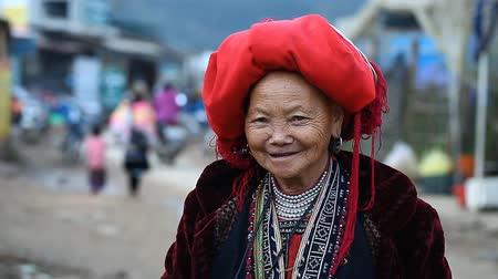 sapa people : Sapa, Vietnam - November 30, 2016 : A woman from the ethnic group of red Dao in a national costume . Posing in front of tourists and selling souvenirs is one of the main sources of income for Hmong