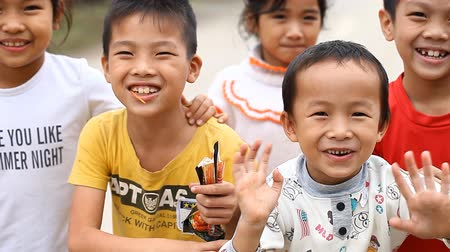 documentary : Phong Nha,Vietnam-December 12,2016: Children from the vicinity of Phong Nha are in interest in contacting a foreigner. To see a person with European appearance is always an event in local villages. Stock Footage