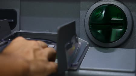 ATM close-up and the users hand with a plastic card Stock Footage