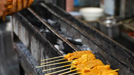 Asian street food . BBQ , Grill on sticks . Fast Food in asian countries Stock Footage