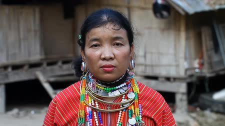 gümrük : Chiang Mai,Thailand-February 13 ,2017:Video portrait of an adult woman with tunnels in the ears from the hill tribe Kayaw living in Eco-Agricultural Hill Tribes Village - Baan Tong Luang. Stok Video