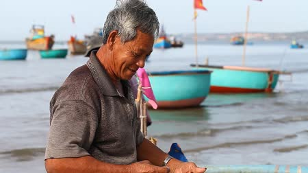 fishing village : Mui Ne, Vietnam-January 04,2017: Fishery and the sale of seafood is a major source of income for residents of coastal towns and villages in Vietnam. Stock Footage