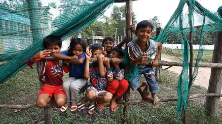 ghetto streets : Siam Reap, Cambodia - January 13, 2017: A group of Cambodian children from a poor village near Angkor Wat