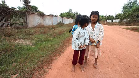ghetto streets : Siam Reap, Cambodia - January 13, 2017: Two little Cambodian girls from a poor village near Angkor Wat. Stock Footage
