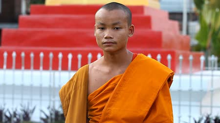 prabang : LUANG PRABANG, LAOS - DECEMBER 9, 2016:Video portrait of a young Buddhist monk. Monks are educated in Buddhist schools at the citys temples