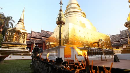 relics : Buddhism.Buddhist temple. Golden stupa in the temple Wat Phra Singh .Chang Mai,Northern Thailand
