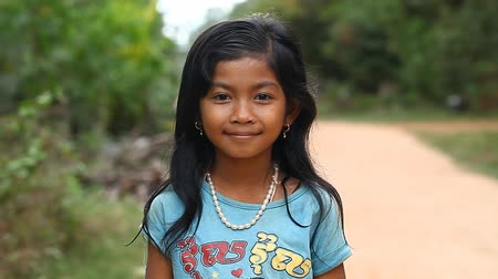 ghetto streets : Siam Reap, Cambodia - January 13, 2017: Video portrait of a little Cambodian girl . Children from poor villages and slums in Cambodia .