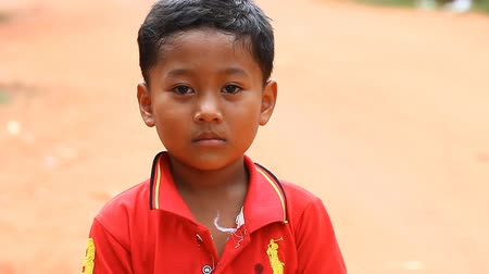 slum : Siam Reap, Cambodia - January 13, 2017: Video portrait of a little Cambodian boy . Children from poor villages and slums in Cambodia .