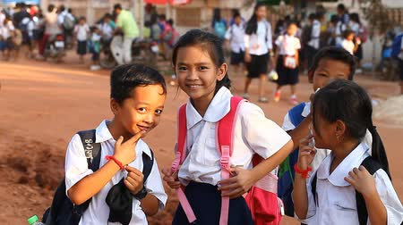 third world : Siam Reap, Cambodia - January 12, 2017: A group of Cambodian schoolchildren returning home after school .