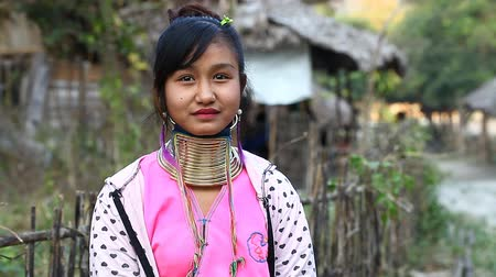 hill tribe : Chiang Mai,Thailand-February 13 ,2017:Video portrait of a young girl from the hill tribe The long-neck karen called themselves as Kayan living in Eco-Agricultural Hill Tribes Village - Baan Tong Luang