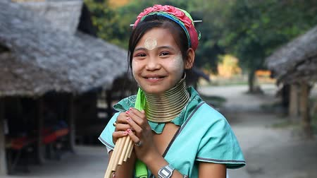 long neck karen : Chiang Mai,Thailand-February 13 ,2017:Video portrait of a young girl from the hill tribe The long-neck karen called themselves as Kayan living in Eco-Agricultural Hill Tribes Village - Baan Tong Luang