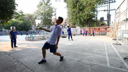 schoolyard : Chiang Mai,Thailand-February 14 ,2017:Thai schoolchildren in the school yard play ball during the change. Stock Footage