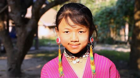 hill tribe : Chiang Mai,Thailand-February 13 ,2017:Video portrait of a young girl from the hill tribe Kayaw living in Eco-Agricultural Hill Tribes Village - Baan Tong Luang.They are a subgroup of Karen tribe.