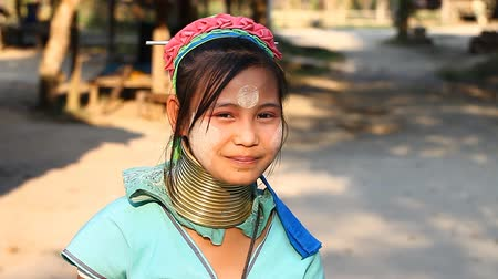 mianmar : Chiang Mai,Thailand-February 13 ,2017:Video portrait of a young girl from the hill tribe The long-neck karen called themselves as Kayan living in Eco-Agricultural Hill Tribes Village - Baan Tong Luang