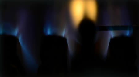 grzejnik : Extreme closeup of gas boiler heater burning with water sound on the background.