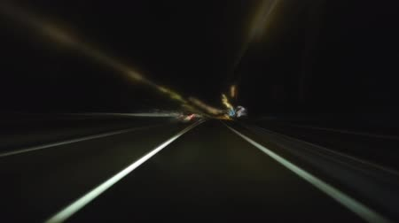 Time lapse of freeway car driving at night.