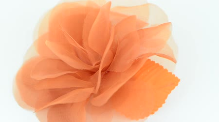 bez : Orange fabric flower on a white background.