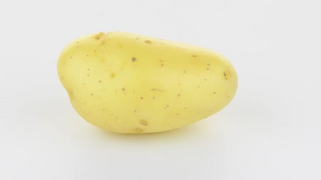 papa : New potato tuber rotating on white background.