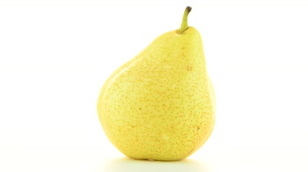 dönen : Pear rotating on white background. Stok Video