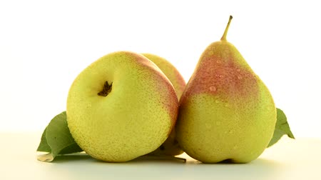 pivoting : Three pears rotating on white background.