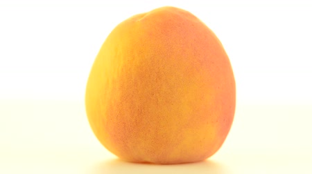 pivoting : Peach rotating on white background.