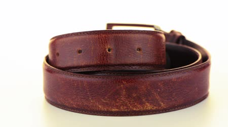 ремень : Leather belt rotating on white background.